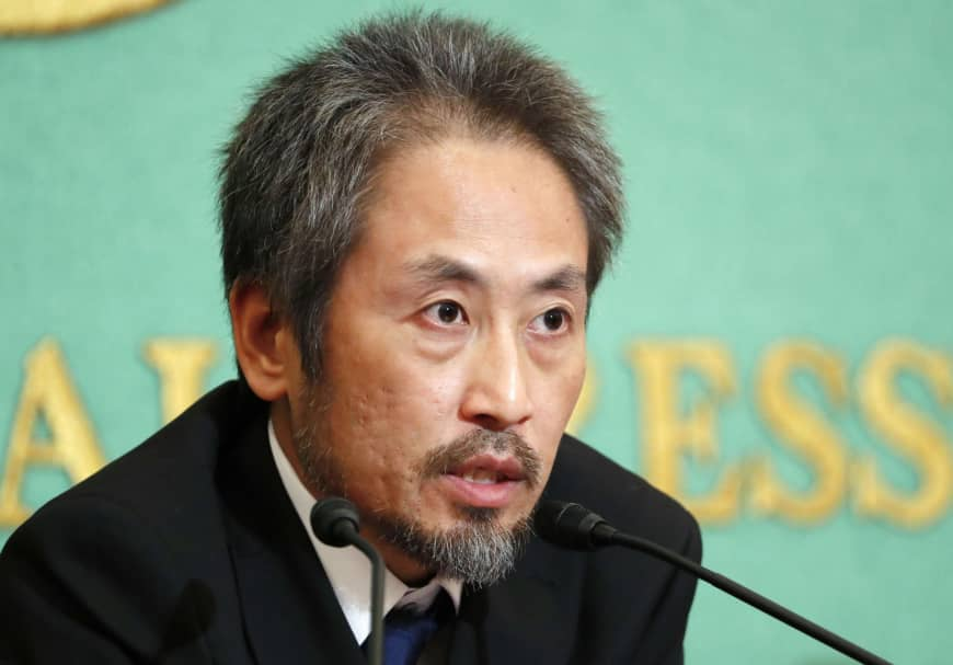 Journalist Jumpei Yasuda speaks at a press conference in Tokyo on Nov. 2.