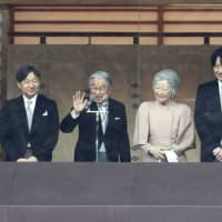 Emperor Akihito and other members of the Imperial family appear on a balcony at the Imperial Palace in Tokyo to greet a crowd gathered to celebrate his 85th birthday on Dec. 23. The event was the last opportunity for the general public to visit the palace for the birthday of Emperor Akihito, who is set to abdicate on April 30. | KYODO
