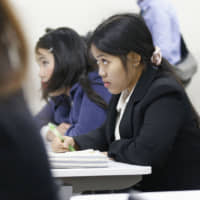 Foreign caregiver trainees attend a study session in Sendai. | KYODO