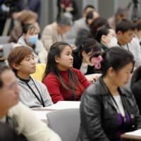 Foreign intern trainees attend a rally organized by a support group at the Diet building in Tokyo on Nov. 22. | KYODO