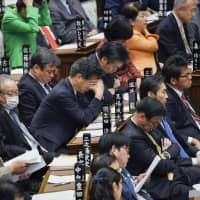 Tired Upper House members wait to vote on a new immigration law Dec. 8. | KYODO