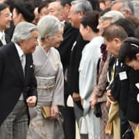 Emperor Akihito and Empress Michiko greet guests during the annual autumn garden party at the Imperial garden at Akasaka Palace in Tokyo in 2014. | AFP-JIJI