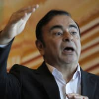 Former Nissan Chairman Carlos Ghosn speaks during an interview in Hong Kong on April 20, 2018. | AP