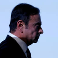 Carlos Ghosn may be charged with financial crimes as early as Monday, sources have said. | REUTERS