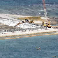 Land reclamation work starts off the Henoko district in Nago, Okinawa Prefecture, on Friday to build the replacement site for U.S. Marine Corps Air Station Futenma. | KYODO