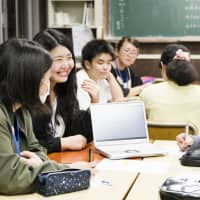 Teenagers attending an educational program provided by DxP, a group that mainly supports social recluses and drop-outs, are taught about how to deal with life's struggles from adult volunteers.   COURTESY OF NORIAKI IMAI