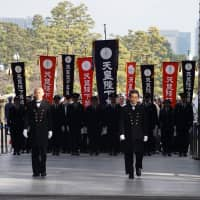 Members of the Imperial Guard led the way as people were allowed into the palace grounds. | RYUSEI TAKAHASHI