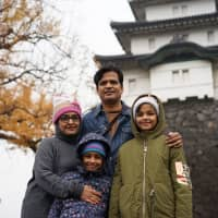 Runa Ashish (left) and her family were visiting Japan this past week. It was their first time in the country, and coming from India, she said it was interesting to see the love and adoration the Japanese people have for the Emperor.  | RYUSEI TAKAHASHI