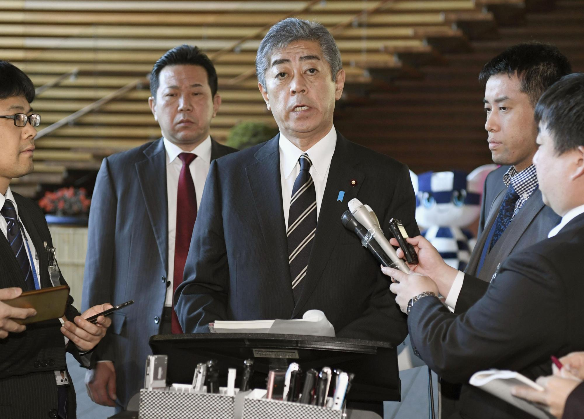 Defense Minister Takeshi Iwaya speaks to reporters at the Prime Minister's Office in Tokyo on Friday about the government's launch of full-fledged offshore land reclamation work necessary for the relocation of a key U.S. military base in Okinawa Prefecture. | KYODO
