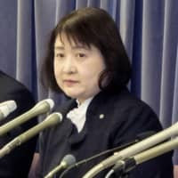 Eri Abe, head of Japan Airline Co.'s cabin attendants division, holds a news conference Tuesday at the transport ministry. | KYODO