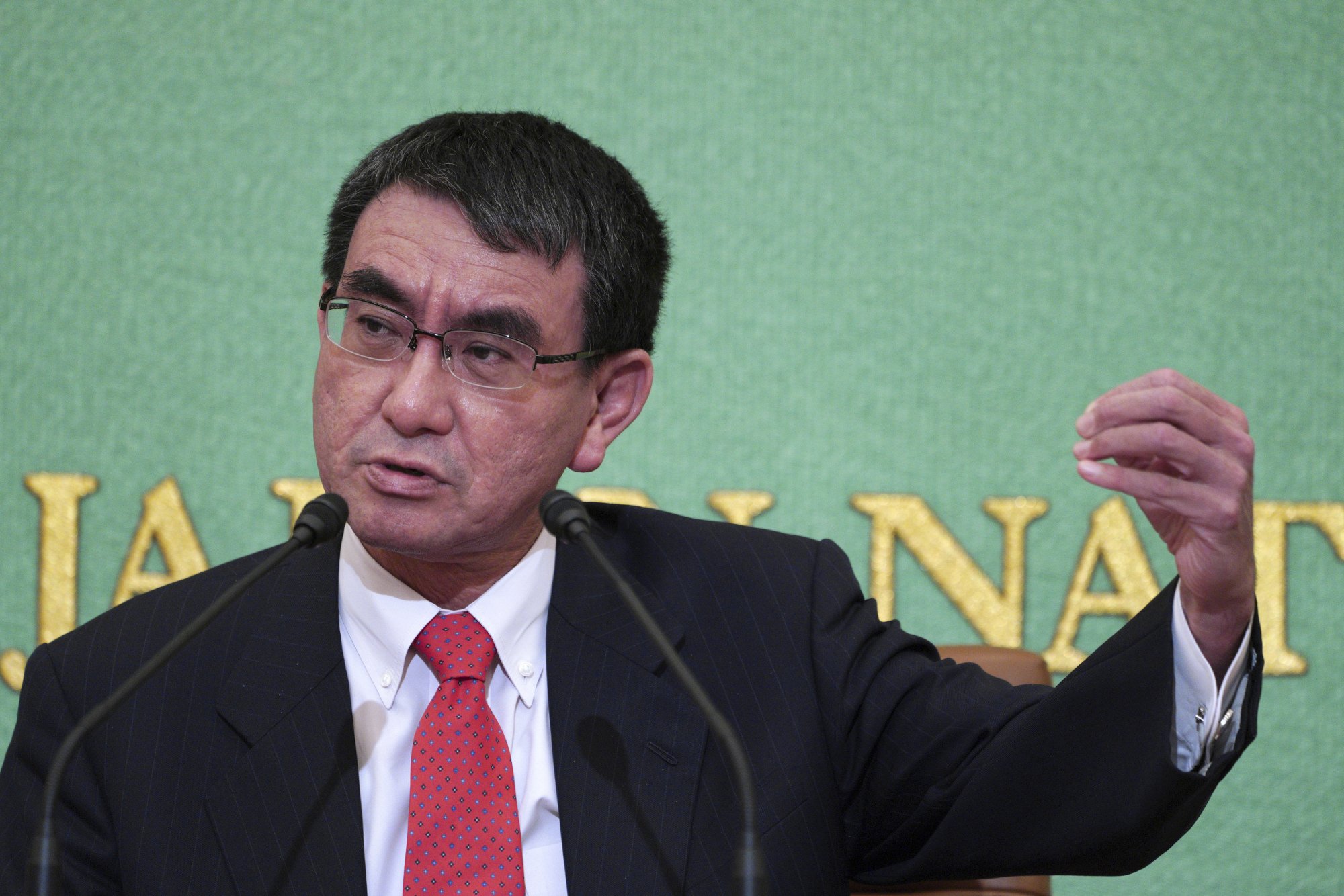Foreign Minister Taro Kono speaks about Japan's ties with South Korea, which have been soured by wartime historical issues, during a news conference Wednesday at the Japan National Press Club in Tokyo. | AP