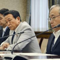 Finance Minister Taro Aso (second from right) attends the inaugural meeting of the ministry's compliance promotion panel on July 31. | KYODO