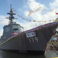 A new Maya-class destroyer is launched by the Maritime Self-Defence Force in Yokohama in July. The government is considering sending MSDF vessels to the Chinese navy's fleet review in April to promote exchanges between the two military forces. | KYODO