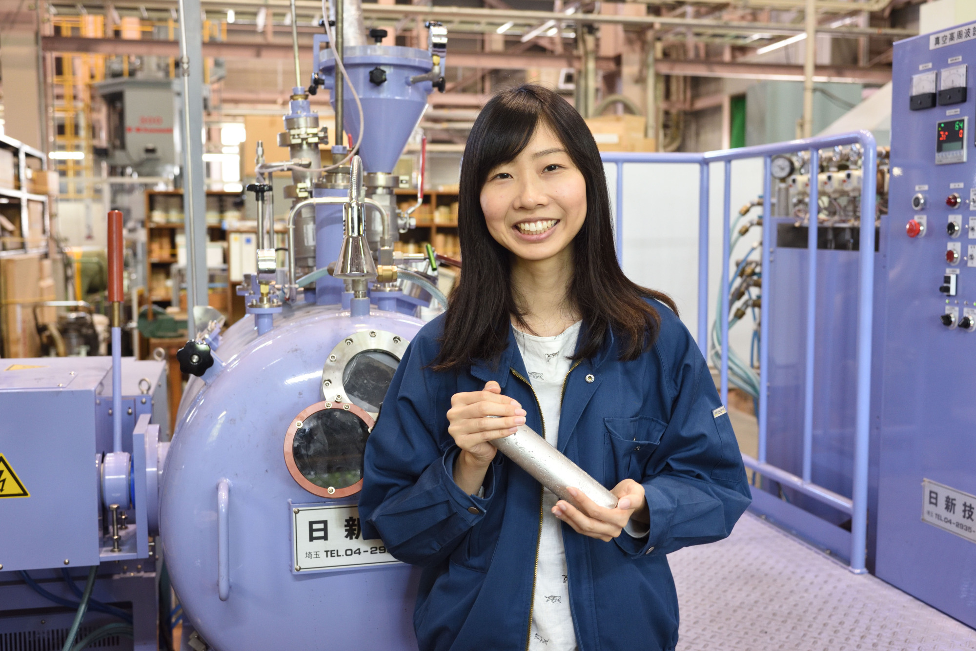 Yukiko Ogawa, 28, stands next to the induction melting furnace in her lab at the National Institute for Materials Science in Tsukuba, Ibaraki Prefecture.  | NATIONAL INSTITUTE FOR MATERIALS SCIENCE