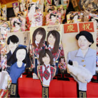 Wooden paddles depicting standouts of the Heisei Era are displayed Monday at Sensoji Temple in Taito Ward, Tokyo. The exhibition started the same day and continues until Wednesday. | KYODO