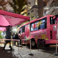 A team of volunteers go about setting up Tsubomi Cafe, a sanctuary for teen runaway girls and those roaming the streets — many of whom face the risk of sexual exploitation — where they can go to have positive interactions with adults, on Dec. 12 in Tokyo's Shibuya Ward. | SATOKO KAWASAKI