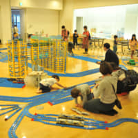 Families play with Plarail laid out by Purafesu organizers in the city of Saitama on Saturday.   ANDREW MCKIRDY