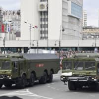 According to an internal Russian government document, Moscow is planning to deploy missile systems including what is called the Bastion, seen in this photo taken during a military parade in Vladivostok in May, on six islands and on the Kamchatka Peninsula, by 2020. | KYODO