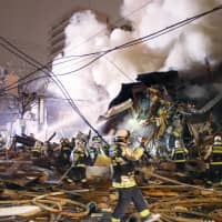 Firefighters try to extinguish a fire following an explosion at a restaurant in Toyohira Ward, Sapporo, on Sunday evening. Several people were reportedly injured by the blast, but the cause of the explosion was not immediately known. | KYODO