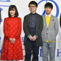 Film director Makoto Shinkai (center), best known for directing 'Kimi no Na wa' ('Your Name.') — one of the highest-grossing Japanese films — stands alongside actor Kotaro Daigo and actress Nana Mori at a news conference in Tokyo on Thursday. Shinkai said his next anime film, 'Tenki no Ko' ('Weathering With You'), will be released in July 2019. | KYODO