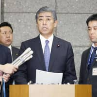 Defense Minister Takeshi Iwaya speaks during a news conference on Friday night. | KYODO