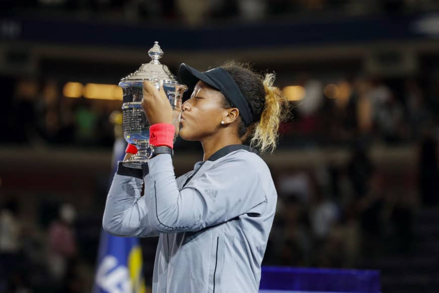 Naomi Osaka kisses the trophy after winning at the U.S. Open in New York in September.