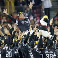 Fukuoka SoftBank Hawks manager Kimiyasu Kudo is tossed in the air after his team won the Japan Series title in November. | KYODO