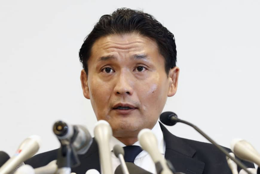 Ongoing issues in the ring: Sumo stablemaster Takanohana announces his resignation from the Japan Sumo Association at a news conference in September.