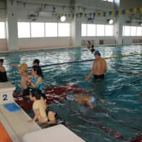 Pioneering swim club gives Japanese with disabilities the chance to excel