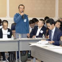 A foreign trainee speaks during a session organized by lawmakers of opposition parties in November at the Diet. | KYODO