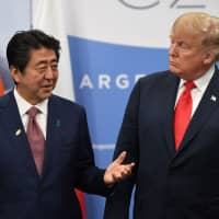 Prime Minister Shinzo Abe speaks with U.S. President Donald Trump during a meeting on the sidelines of the Group of 20 summit in Buenos Aires on Friday. | AFP-JIJI