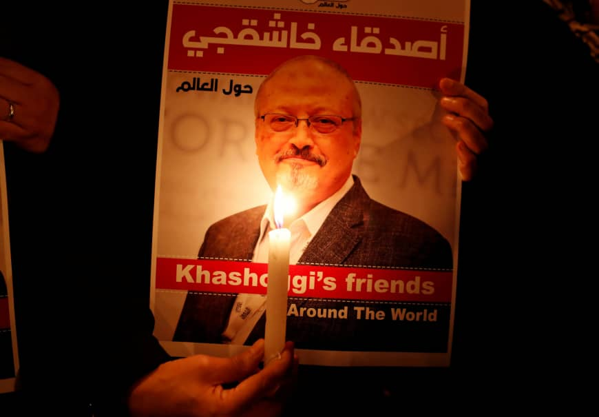 A demonstrator outside the Saudi Arabian consulate in Istanbul holds a poster of Saudi journalist Jamal Khashoggi who was allegedly killed and dismembered inside the consulate.