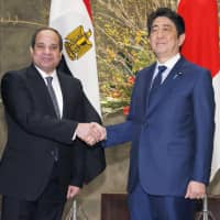 Prime Minister Shinzo Abe and Egyptian President Abdel-Fattah el-Sissi shake hands in Tokyo before starting a meeting on Feb. 29, 2016. The leaders announced their joint partnership on education during el-Sissi's visit. | KYODO
