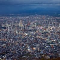 Host city: Sapporo, the largest city in Hokkaido, as seen at dusk from the viewing deck of Mount Moiwa. Sapporo is one of the 12 cities in Japan that will host the Rugby World Cup in 2019. | OSCAR BOYD
