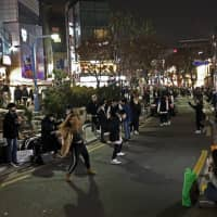On weekend nights, the student-friendly Hongdae neighborhood is filled with dancers mimicking K-pop choreography. | PATRICK ST. MICHEL