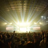Party all night: Festivalgoers enjoy a live performance at last year's Countdown Japan.