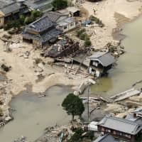 Record rainfall: Houses that were damaged in flooding sit in Kurashiki, Okayama Prefecture, in July following torrential rain. | KYODO