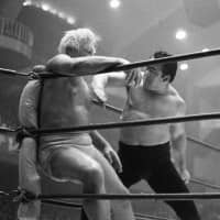 Wrestler Rikidozan strikes an opponent during a bout in 1962. | KYODO