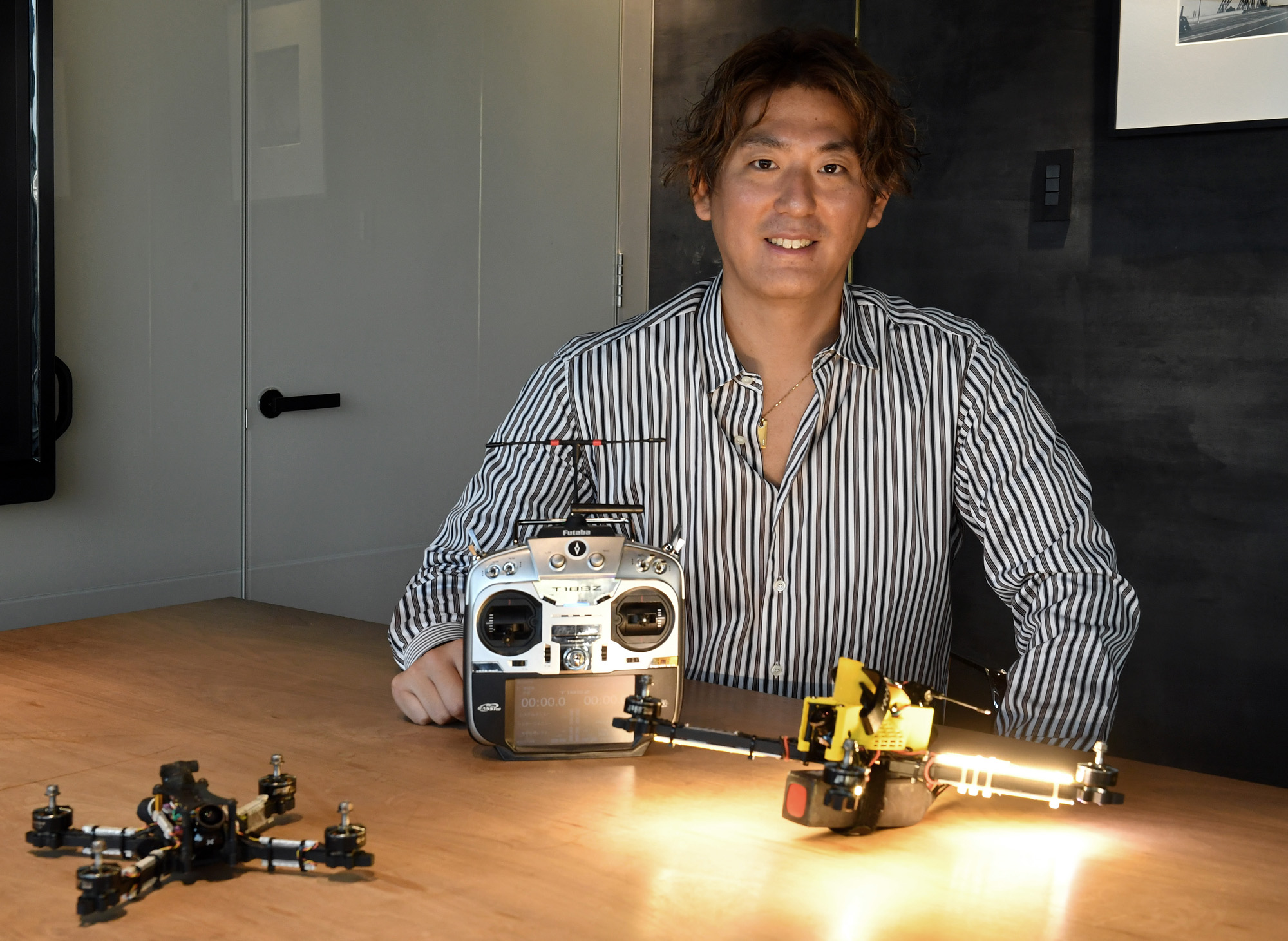 Drone racer Junichi Goto poses for a photograph at The Japan Times