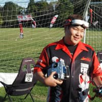 Japan Drone League's 2018 overall champion, Takafumi Oka, smiles after a race in October.   MARK THOMPSON