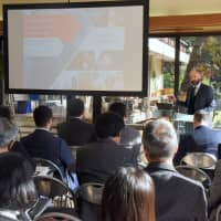 An audience, mainly comprising executives of Japanese companies considering investing in Italy, listen to presentations at the Invest in Italy Roadshow, held at the Italian ambassador's residence inside the Italian Embassy in Tokyo's Minato Ward on Dec. 13. | SATOKO KAWASAKI