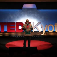 Speaking up: Baye McNeil gives a presentation titled 'Unpacking Your Intangibles' at TED×Kyoto 2018 in November. | PHOTO BY HIROMASA AKAISHI, COURTESY OF TEDxKYOTO