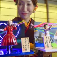 What a doll: The Togyoku doll-making company releases its 'newsmaker' series every year. This year's products included doll versions of singer Namie Amuro and athletes Yuzuru Hanyu and Nao Kodaira. | KYODO