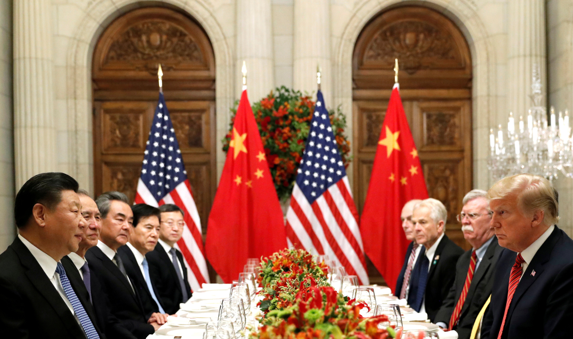 U.S. President Donald Trump and Chinese leader Xi Jinping attend a working dinner Dec. 1 in Buenos Aires. | REUTERS