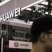 Ownership of China's most advanced technology companies, including Huawei, is murky, but many believe they are controlled by the state. | BLOOMBERG