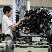 An employee works on the chassis assembly line at the BMW Brilliance Automotive Ltd. Tiexi plant  near Shenyang, China. | BLOOMBERG