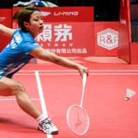 Nozomi Okuhara hits a return against Akane Yamaguchi in the women's semifinals at the BWF World Tour Finals in Guangzhou, China, on Saturday. | AFP-JIJI