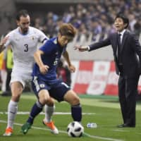 Samurai Blue head coach Hajime Moriyasu reacts during the team's Oct. 16 friendly against Uruguay in Saitama. Moriyasu has announced his intent to take a full-strength squad to next year's Copa America, where Japan will participate as invited guests. | KYODO