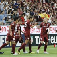 The J. League hopes that players such as Vissel's Andres Iniesta (second from right) will not only raise attendance, but improve the level of skill on the pitch. | KYODO