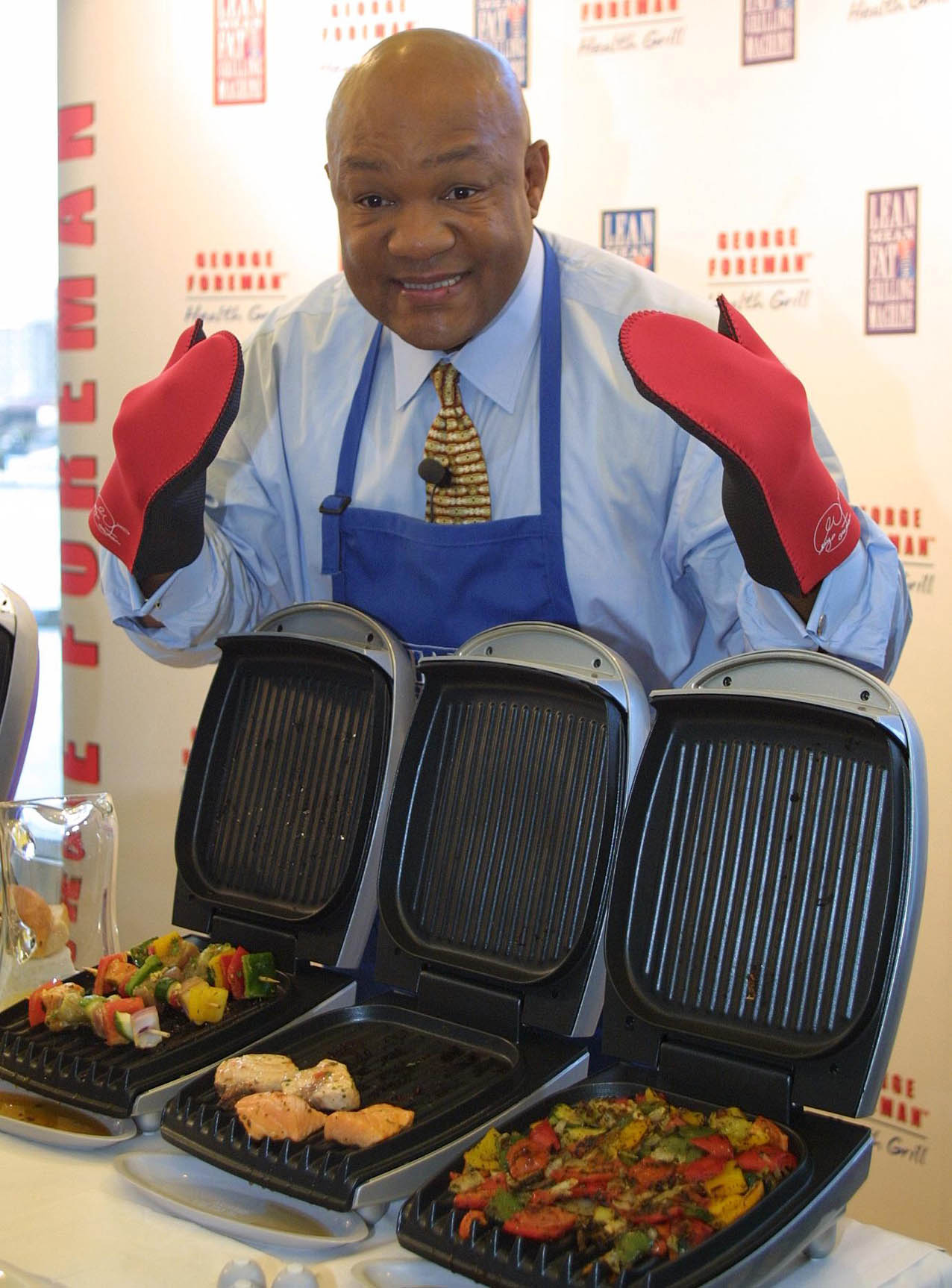 George Foreman found success after his boxing career as a businessman with the George Foreman Lean Mean Fat-Reducing Grilling Machine, which has sold over 120 million units worldwide. | AP